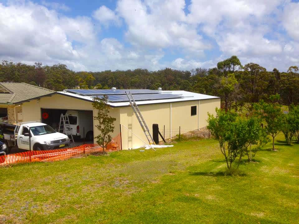 front shed with SolaXs solar panel roof